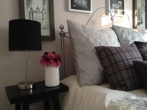 grey bedroom with pink flowers in a vase