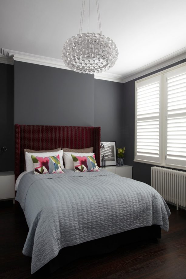 grey bedroom with stripes dark red headboard