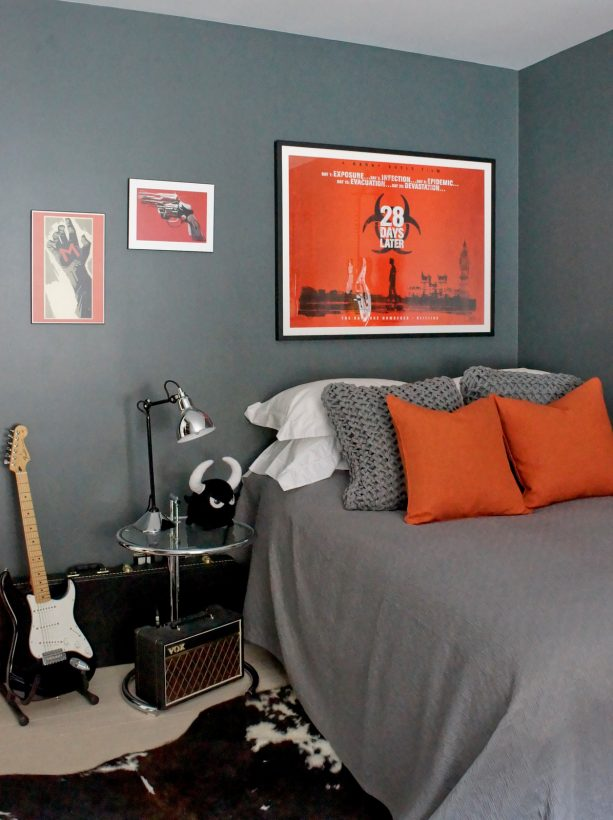 medium grey bedroom with stunning red wall art