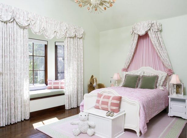 pink and grey bedroom with pink patterned wall-mounted bed canopy