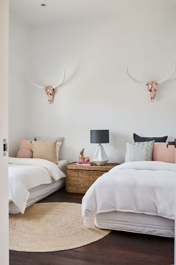 pink and grey bedroom with rose gold accents