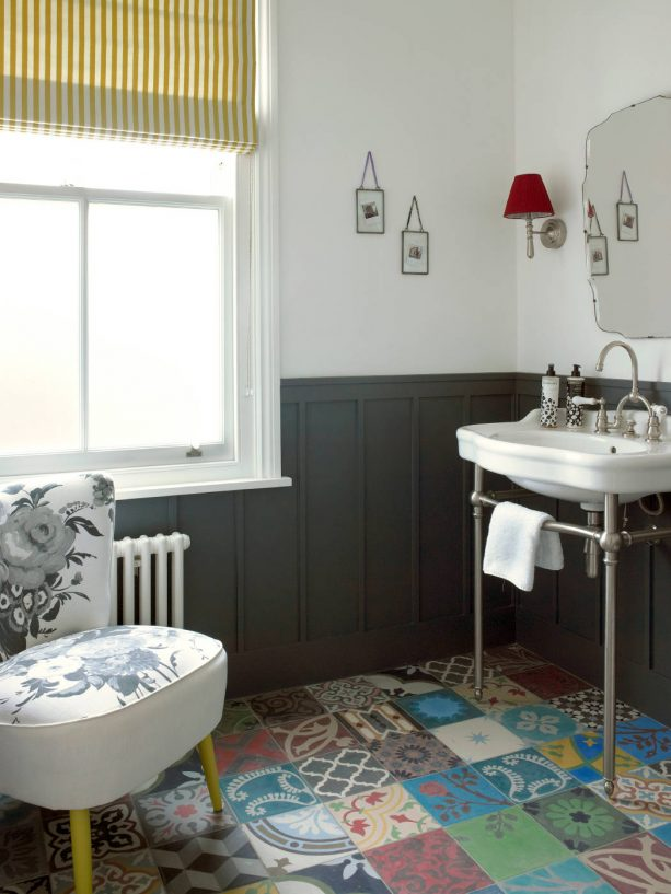 powder room with black board and batten wainscoting