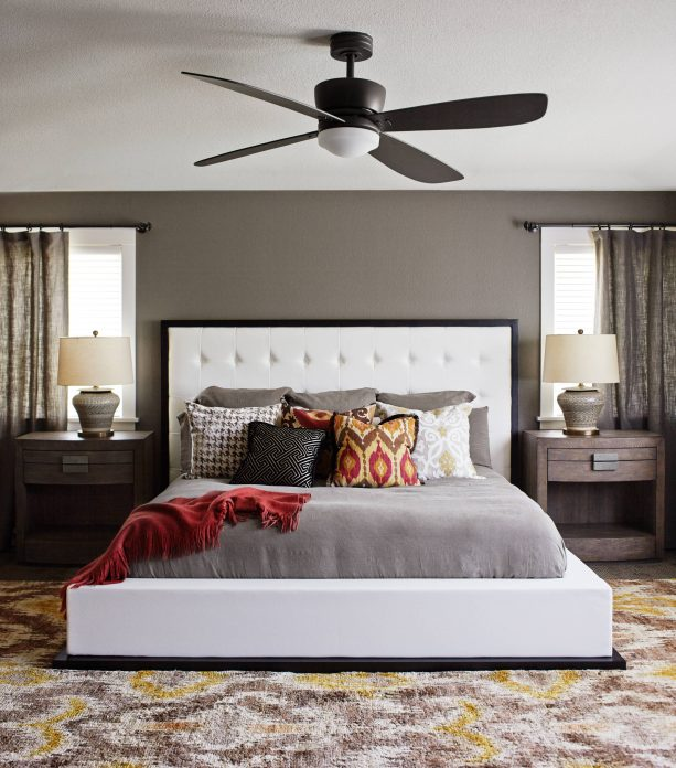 red and grey bedroom with white bed and white ceiling