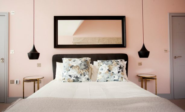 soft pink and grey bedroom with black accents