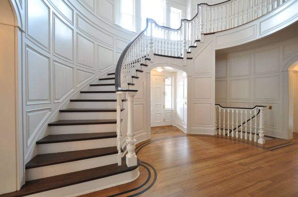 staircase with raised panel wainscoting