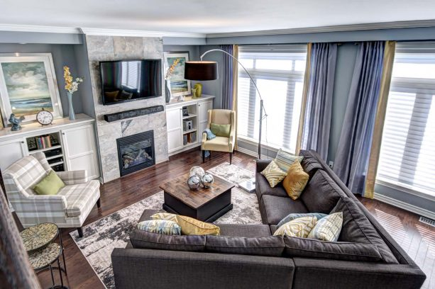 a slightly cheerful living room with grey, mustard, and green colors
