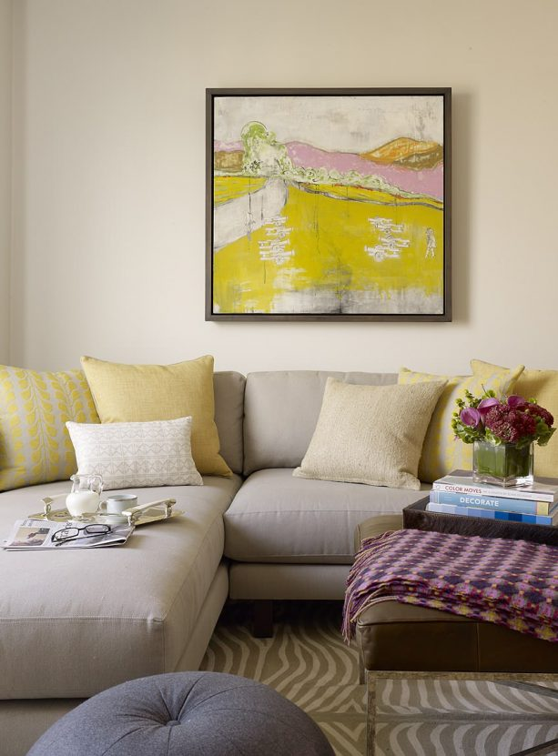 greige sectional sofa with mixed-pattern mustard cushions