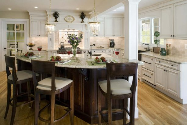 off-white cabinets, dark wood island, and some stools combination