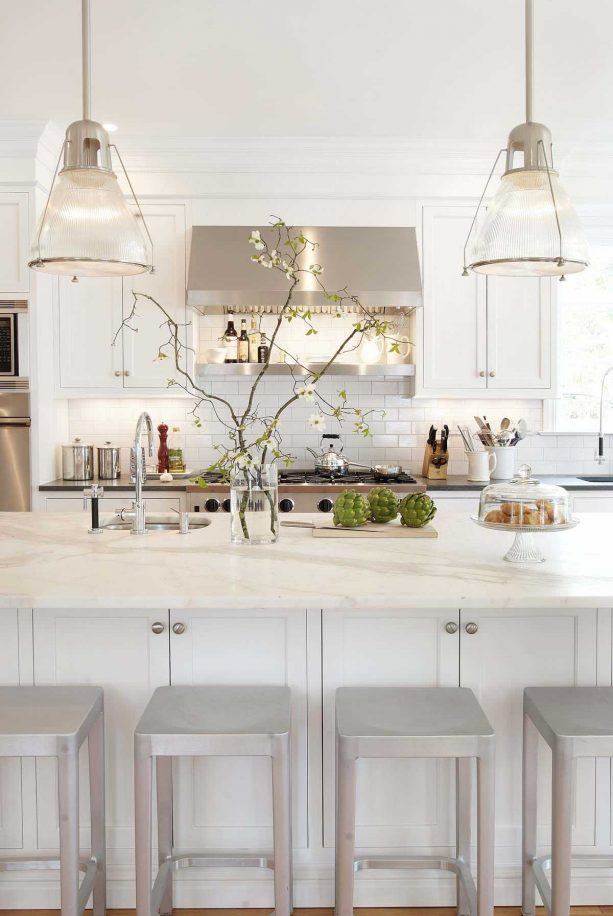 off-white cabinets paired with warm white granite countertops