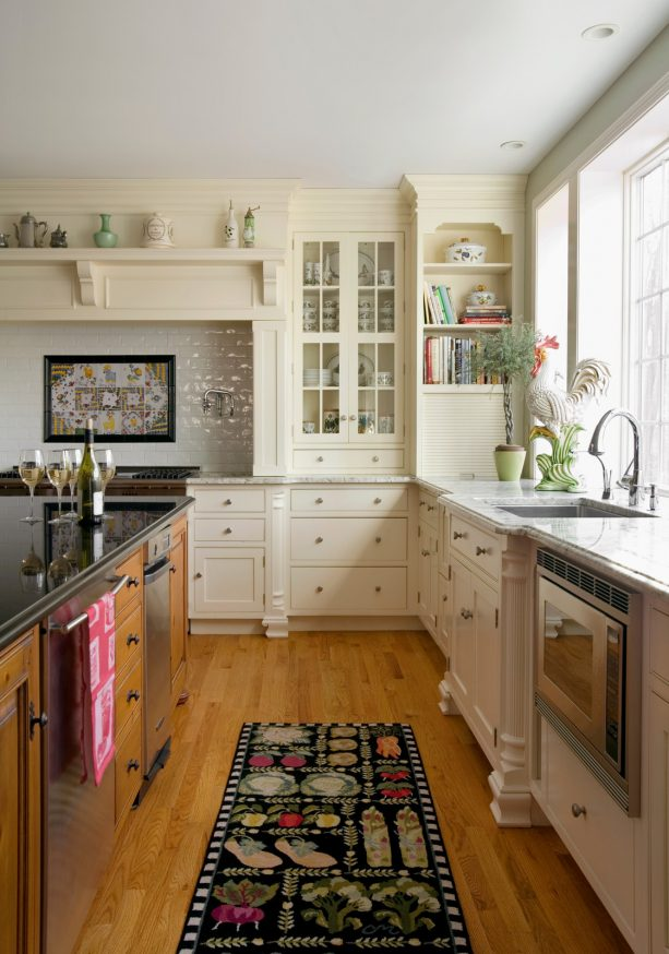 off-white cabinets with a built-in bookshelf at the corner