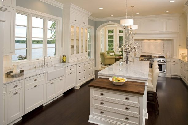 off-white kitchen cabinets featuring a butcher block top for pastry counter