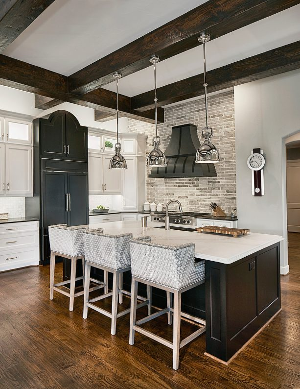 white shaker kitchen cabinets paired with black kitchen island
