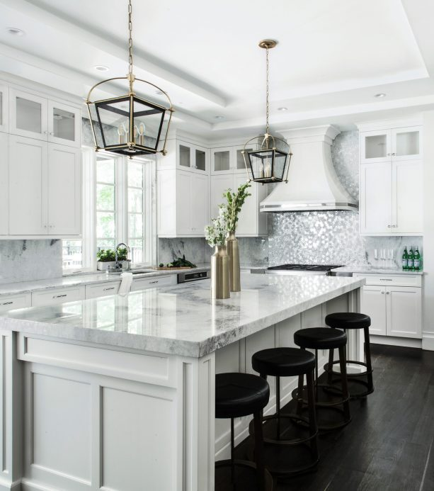 white shaker kitchen cabinets paired with metallic silver white backsplash