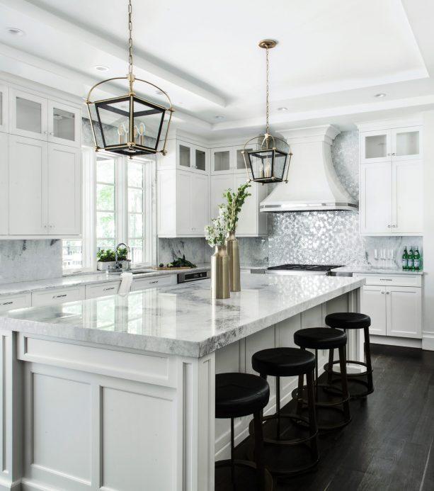 white shaker kitchen cabinets paired with metallic silver white backsplash