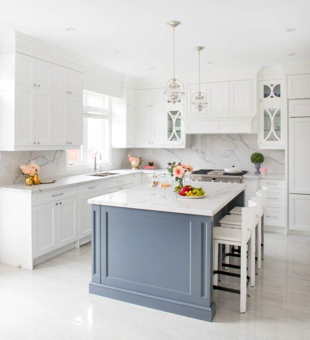 white shaker kitchen cabinets paired with veined white quartz backsplash