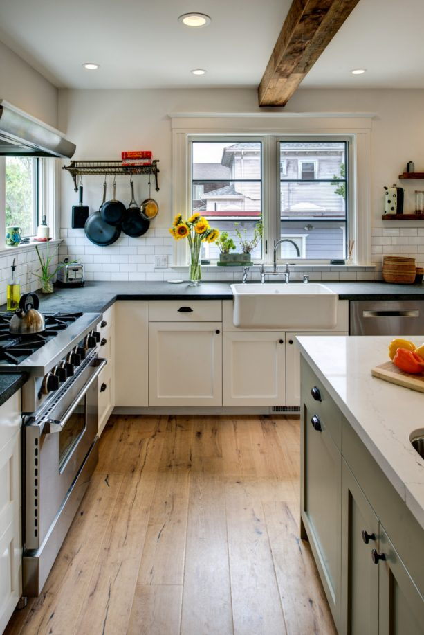 white shaker kitchen cabinets with black countertops