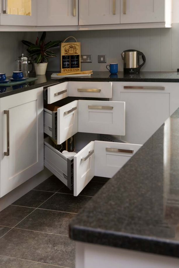 white shaker kitchen cabinets with corner cabinet drawers