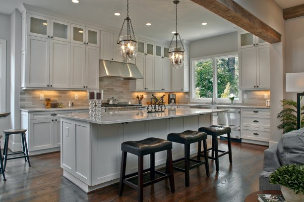 white shaker kitchen cabinets with simple round knobs