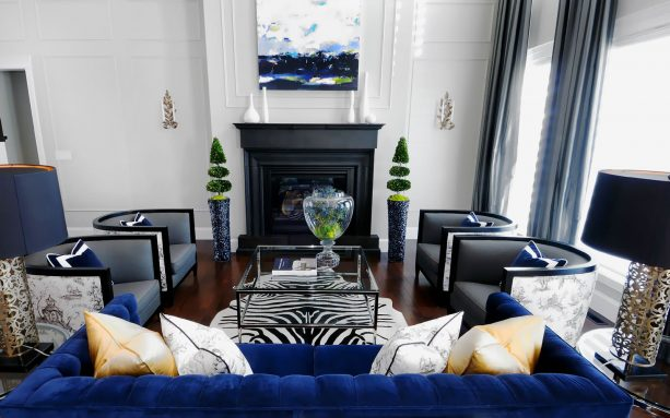 a living room with navy blue, black, and grey theme