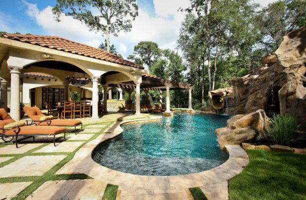 small inground pool with stunning full-size grotto
