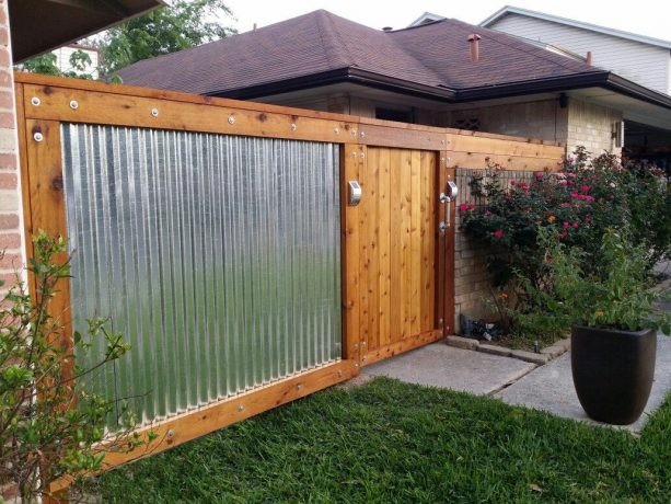 corrugated metal fence with cedar wood frame and door