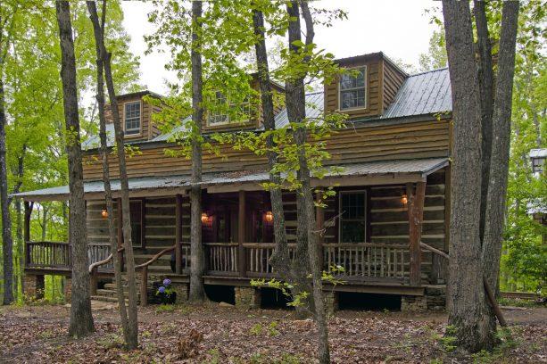 rustic wood porch railing in a log cabin