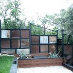 rusty corrugated metal fence with vertical and horizontal design