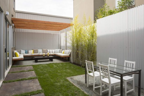 vertical corrugated steel fence with obvious industrial look