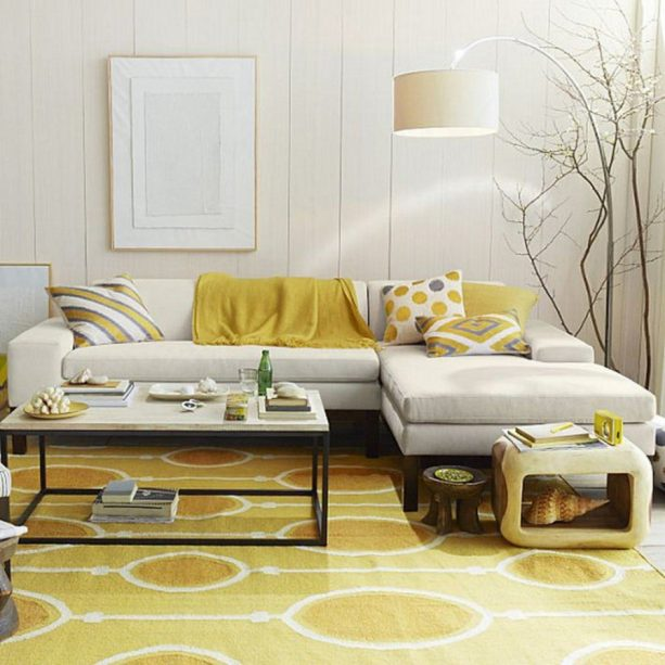 a living room with a large arch floor lamp