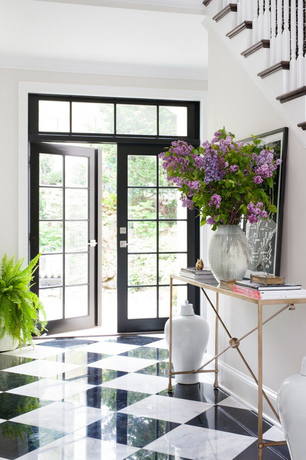 black and white marble floor in a transitional entry