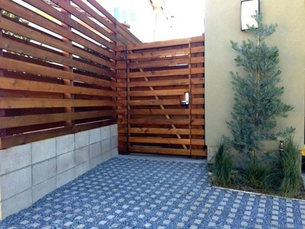 good-looking yet cheap fence from cinder block and wood