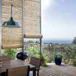 balcony with bamboo blinds for protection from sunlight
