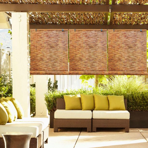 natural-patterned roll up bamboo shades in a patio