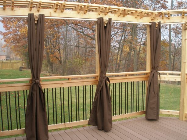 privacy screen for deck from a pergola and brown curtain