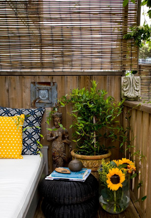 roll up bamboo blind to reduce breeze and add privacy in a patio