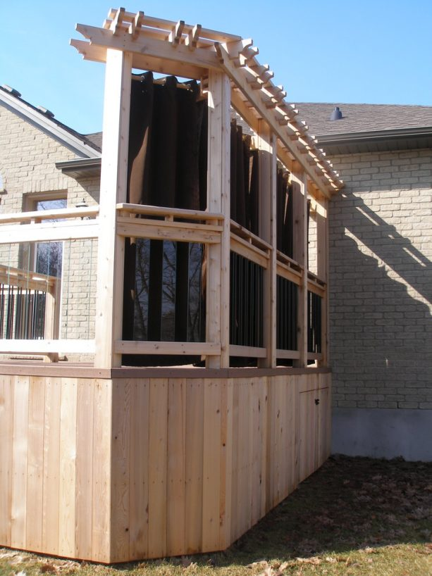 the back view of the pergola and curtains privacy screen
