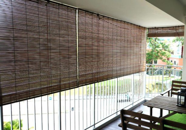 the use of roll-up bamboo blinds in a balcony