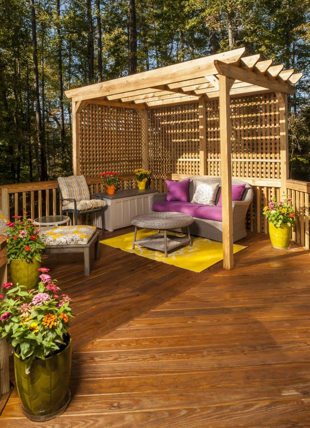 traditional deck with railing, lattice screen, and pergola