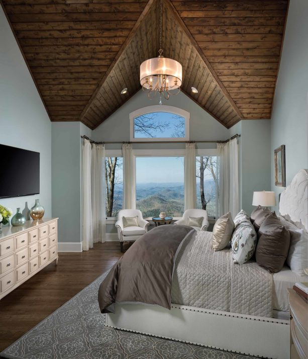 bluish grey wall with hickory wood floor in a traditional bedroom