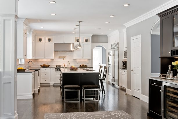 clean traditional kitchen with grey walls and oak-stained floor