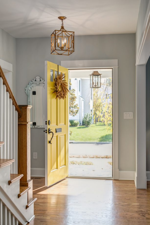 craftsman entry with grey walls, hardwood floor, and a yellow door