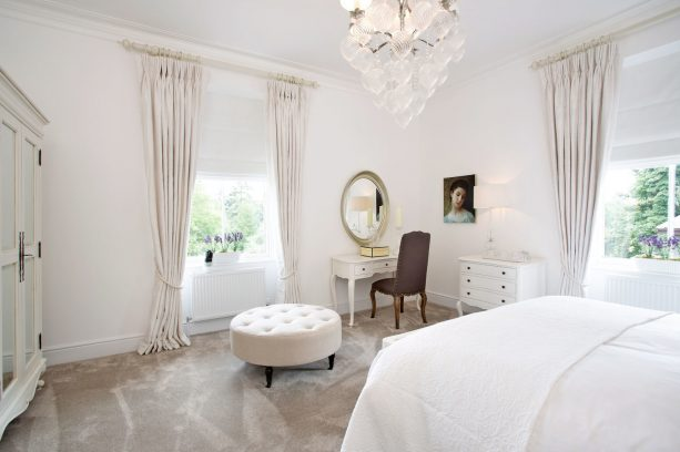 oversized elegant off-white curtains with tiers for a short and wide window