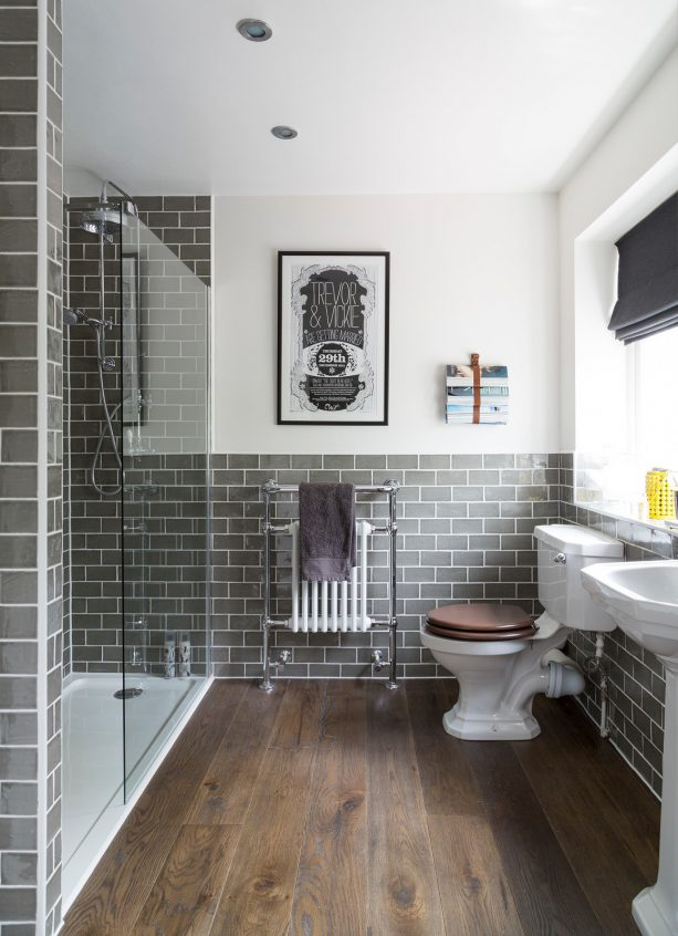 traditional bathroom with grey subway ceramic tile wall and engineered oak floor