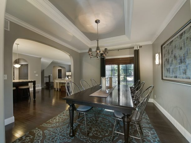 traditional living room with grey walls, white trims, and dark hardwood floor
