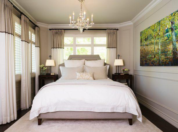 transitional bedroom with warm grey walls and dark wood floor