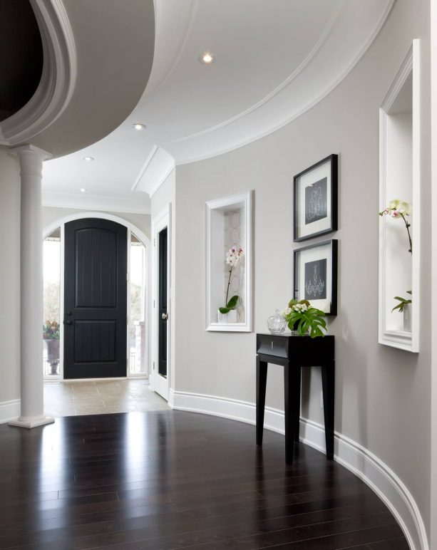 transitional hall with grey walls and dark-stained prefinished hardwood floor