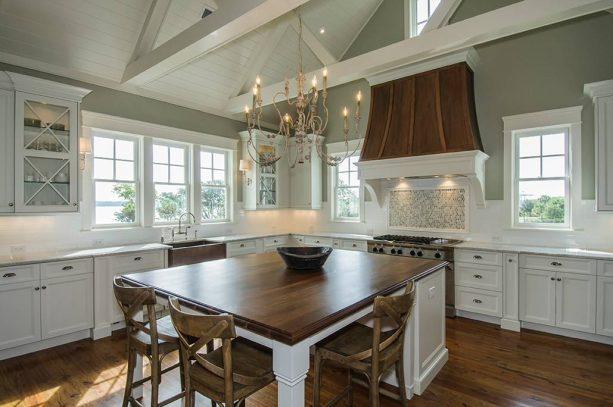transitional kitchen with greenish grey and medium tone oak floor