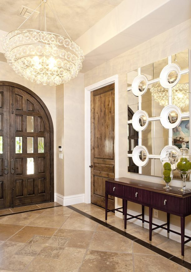 a wood door with medium brown stain and white-painted trim