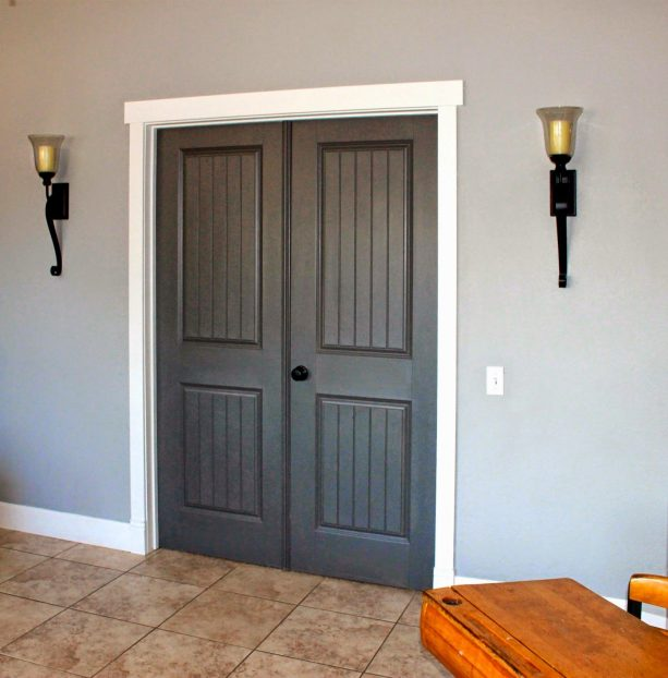 barn-style doors with grey stain and white trims