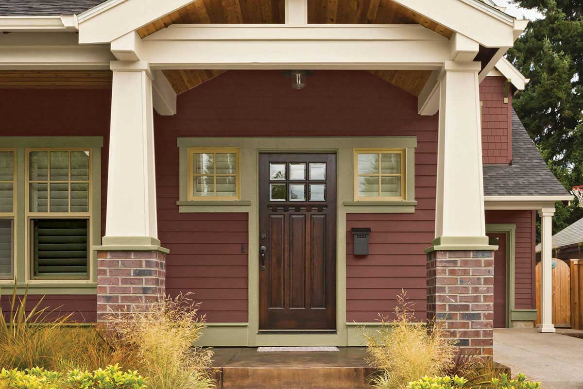 front door with brown stain and oyster tan-painted trim